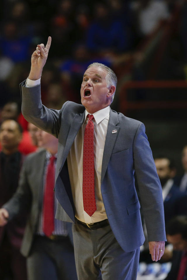 San Diego State head coach Brian Dutcher calls a play against Boise State during the second half of an NCAA college basketball game, Sunday, Feb. 16, 2020, in Boise, Idaho. (AP Photo/Steve Conner)
