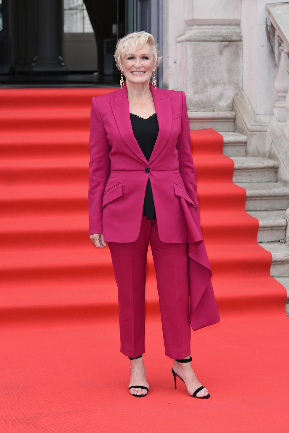<p>We're big into the hot pink suit Glenn wore for a London premiere this month. <em>[Photo: Getty]</em> </p>
