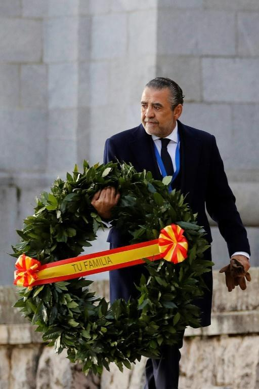 """Franco's grandson, Jaime Martinez Bordiu, carried a wreath with a ribbon saying """"Your family"""" as he arrived for the exhumation (AFP Photo/Juan Carlos Hidalgo)"""