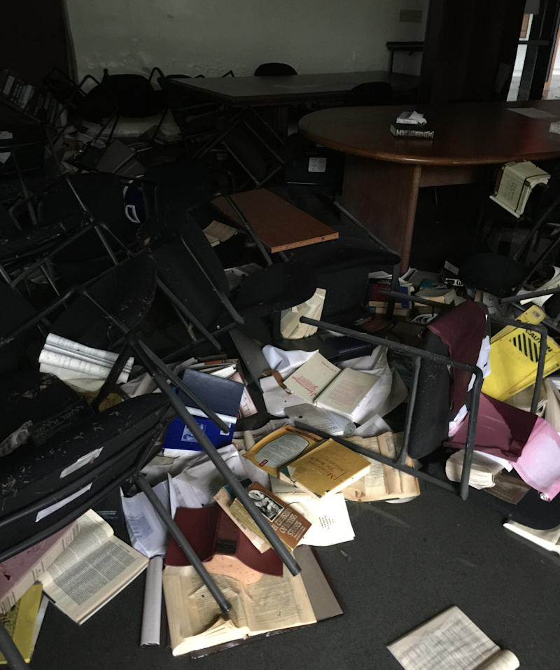 Books toppled and were soaked in floodwater at the synagogue. Donations are helping to replace some of the damaged items.