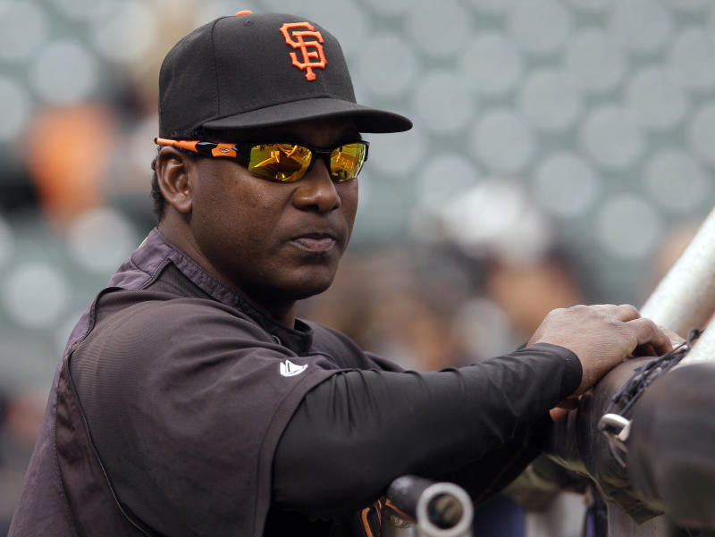 San Francisco Giants batting coach Hensley Meulens watches batting practice before Game 1 of baseball's World Series against the Texas Rangers Wednesday, Oct. 27, 2010, in San Francisco. (AP Photo/Jeff Chiu)