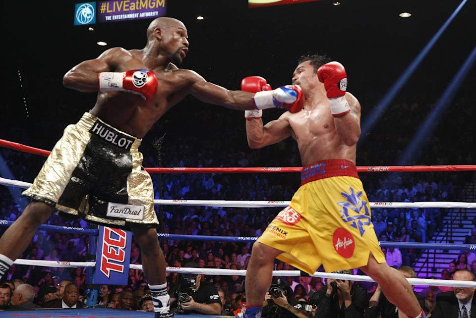 Floyd Mayweather (L) catches Manny Pacquiao with a jab in their heavily hyped 2015 fight. (Getty Images)