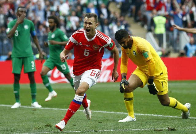 <p>Russia's Denis Cheryshev celebrates after scoring his side's second goal during the group A match between Russia and Saudi Arabia which opens the 2018 soccer World Cup at the Luzhniki stadium in Moscow, Russia, Thursday, June 14, 2018. (AP Photo/Matthias Schrader) </p>