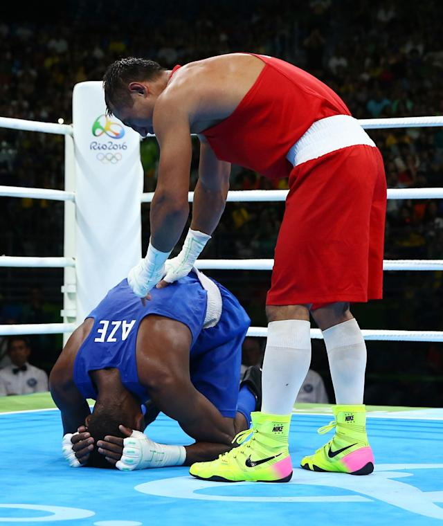 2016 Rio Olympics - Boxing - Final - Men's Light Welter (64kg) Final Bout 272 - Riocentro - Pavilion 6 - Rio de Janeiro, Brazil - 21/08/2016. Fazliddin Gaibnazarov (UZB) of Uzbekistan and Collazo Sotomayor (AZE) of Azerbaijan react after their bout. REUTERS/Peter Cziborra FOR EDITORIAL USE ONLY. NOT FOR SALE FOR MARKETING OR ADVERTISING CAMPAIGNS.