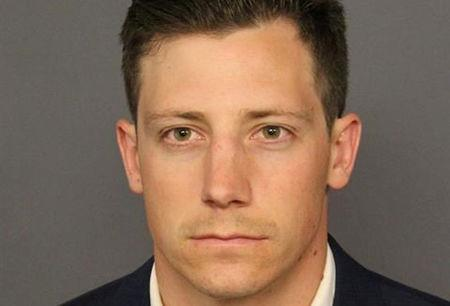 Dancing FBI agent turns self in to Denver police, booked into jail