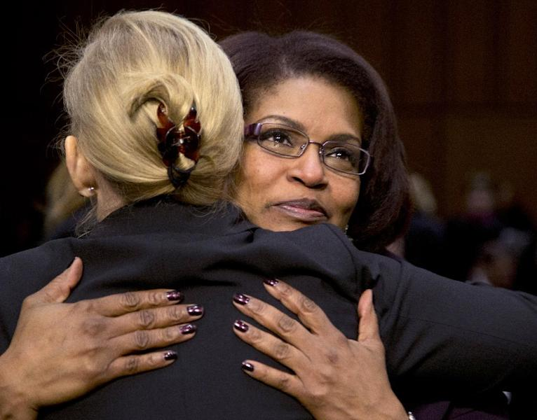 Senate subcommittee on Personnel Chair Sen. Kirsten Gillibrand, D-N.Y., left, hugs BriGette McCoy, a former Specialist in the U.S. Army, after McCoy testified on Capitol Hill in Washington, Wednesday, March 13, 2013, before the subcommittee's hearing to investigate sexual assault in the military. McCoy, a Persian Gulf war veteran, said she was raped when she was 18 and at her first duty station. (AP Photo/Carolyn Kaster)