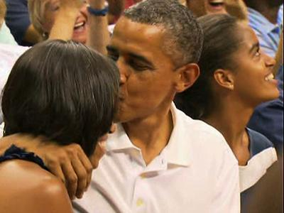 President Obama and the First Lady got caught by the arena 'Kiss Cam,' while watching the U.S. Olympic basketball team in Washington on Monday. The President, Mrs. Obama and Vice President Biden watched the U.S. team play Brazil. (July 16)