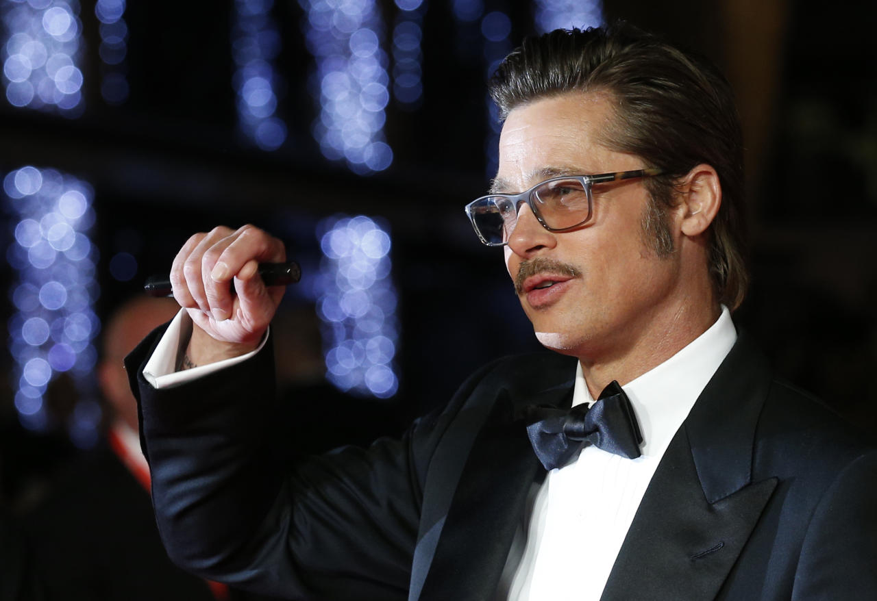 <p>Apparently Brad Pitt used to work for a restaurant called El Pollo Loco, handing out flyers to customers dressed as a chicken. [Photo: PA] </p>