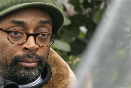 """Film director Spike Lee poses during the making of his film, """"Miracle at St. Anna"""", at Piazza del Popolo in downtown Rome"""