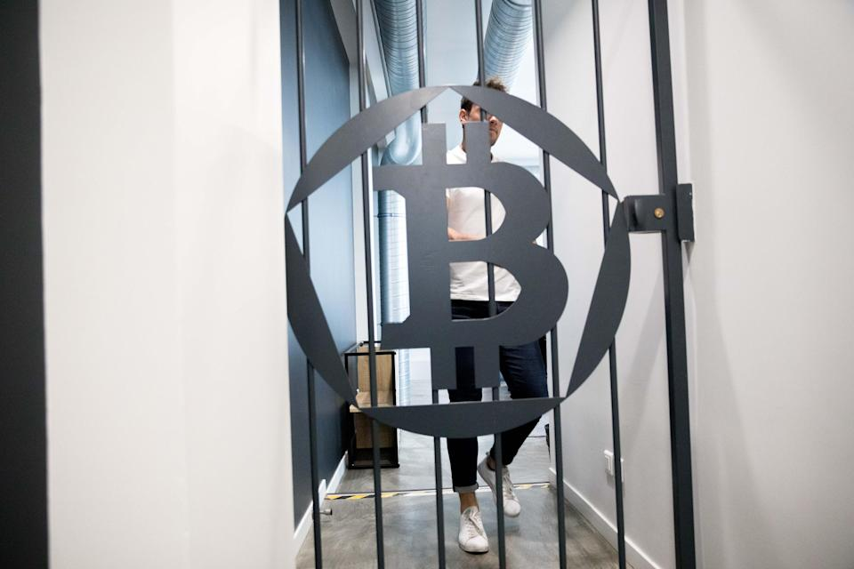 A bitcoin logo sits on a security gate inside the offices of La Maison du Bitcoin bank in Paris, France. (Photo: Getty Images)