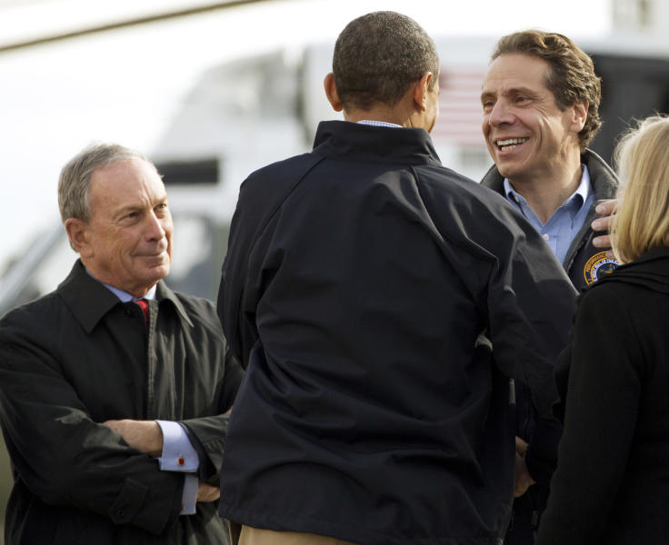FILE - In this Nov. 15, 2012 file photo, President Barack Obama, center, is flanked by New York City Mayor Michael Bloomberg, left, and New York Gov. Andrew Cuomo, after the president arrived at John F. Kennedy International Airport in New York, to visit areas devastated by Superstorm Sandy. Experts in leadership and disaster response give Bloomberg, Cuomo and New Jersey Gov. Chris Christie high marks for their performance so far in Superstorm Sandy, a disaster that left more than 100 people dead and presented perhaps the biggest crisis-management test yet for the three Northeastern politicians who have all been rumored to hold presidential ambitions. (AP Photo/Carolyn Kaster, File)