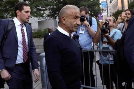 FILE PHOTO: Alain Kaloyeros (C), president of the State University of New York's Polytechnic Institute, walks out of the Manhattan federal courthouse in New York, U.S., September 22, 2016.  REUTERS/Bria Webb