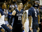 Villanova's Ryan Arcidiacono (15) and Kris Jenkins (2) celebrate during the second half of an NCAA college basketball game Monday, Nov. 24, 2014, in New York. Villanova won the game 77-53. (AP Photo/Frank Franklin II)