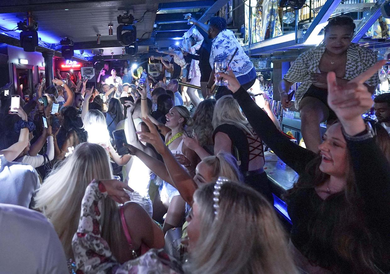 People dancing in Bar Fibre in Leeds after the final legal coronavirus restrictions were lifted in England at midnight. (PA)