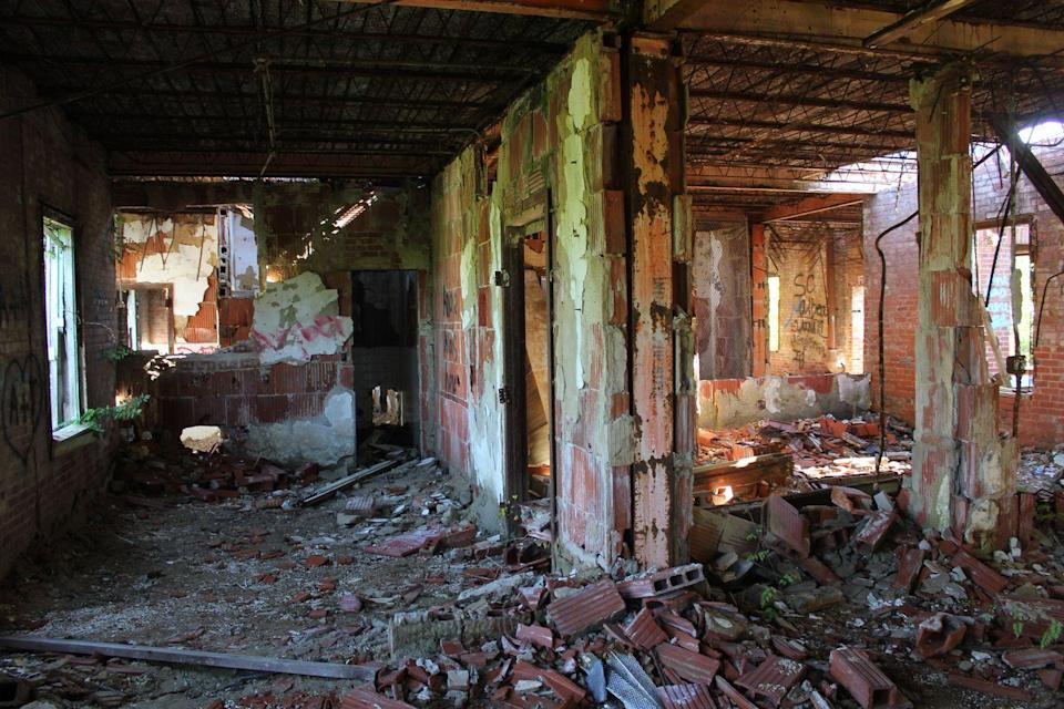"""<p><strong>Jemison Center - Northport, AL</strong><br></p><p>The Northport structure also known as """"Old Bryce"""" has had many different uses over the years. What started as an old plantation house in the early 1900s transitioned into a nursing home until it closed in 2003. However, <a href=""""https://abandonedsoutheast.com/2019/08/25/jemison-center/"""" rel=""""nofollow noopener"""" target=""""_blank"""" data-ylk=""""slk:rumors circulate"""" class=""""link rapid-noclick-resp"""">rumors circulate</a> around the exact use of the property, and many legends support a much darker history.</p><p>Photo: Flickr/<a href=""""https://www.flickr.com/photos/texasbackroads/43839655985/in/photolist-2bgRJDr-28JyDXC-2bgRDWF-29MXGnF-28vPMhf-2a5M4F1-2bcuQmf-2bgRJJg-PmSgM3-2bqsd3Q-2bDhNQY-2bcuQ1f-gRT5Se-2bgRH2Z-2a792y8-28qmYNL-2a5M5ty-2buM4kB-2bDhLdU-PmSghq-2bqskc9-jzJKoo-28JyDJm-28Xmqe1-8BKqe8-jzGSUr-8BNvHE-P97QKs-2bqsngE-MqnD7g-jzGVNc-2bcuQeb-gRTQiv-gRT2zm-28qmW8q-gRT2ch-2bgRG7T-29MXGa6-2a794QH-29MXEGX-2bgRDKD-28XmtH5-g3wwbx-23furX6-MXBfhe-PzDJrU-2aBXiBG-rA7GAU/"""" rel=""""nofollow noopener"""" target=""""_blank"""" data-ylk=""""slk:Nicolas Henderson"""" class=""""link rapid-noclick-resp"""">Nicolas Henderson</a></p>"""