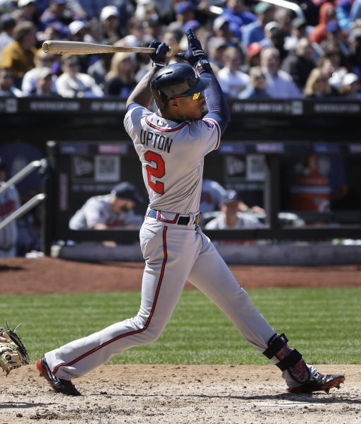 Atlanta Braves' B.J. Upton looks after his RBI double during the fifth inning of a baseball game against the New York Mets, Sunday, April 20, 2014 in New York. (AP Photo/Seth Wenig)