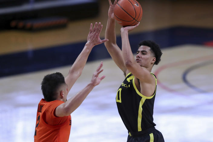 Oregon's Will Richardson (0) shoots over Oregon State's Jarod Lucas (2) during the second half of an NCAA college basketball game in Corvallis, Ore., Sunday, March 7, 2021. (AP Photo/Amanda Loman)