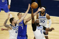 Dallas Mavericks center Dwight Powell (7) battles for a rebound against Minnesota Timberwolves center Naz Reid (11) and forward Juancho Hernangomez (41) in the first quarter during an NBA basketball game, Sunday, May 16, 2021, in Minneapolis. (AP Photo/Andy Clayton-King)