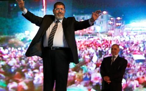 In this May 20, 2012 file photo Morsi, at that stage the Muslim Brotherhood's presidential candidate holds a rally in Cairo - Credit: Fredrik Persson/AP