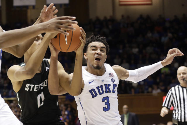Duke's Tre Jones (3) and Stetson's Christiaan Jones (0) reach for the ball during the first half of an NCAA college basketball game in Durham, N.C., Saturday, Dec. 1, 2018. (AP Photo/Gerry Broome)