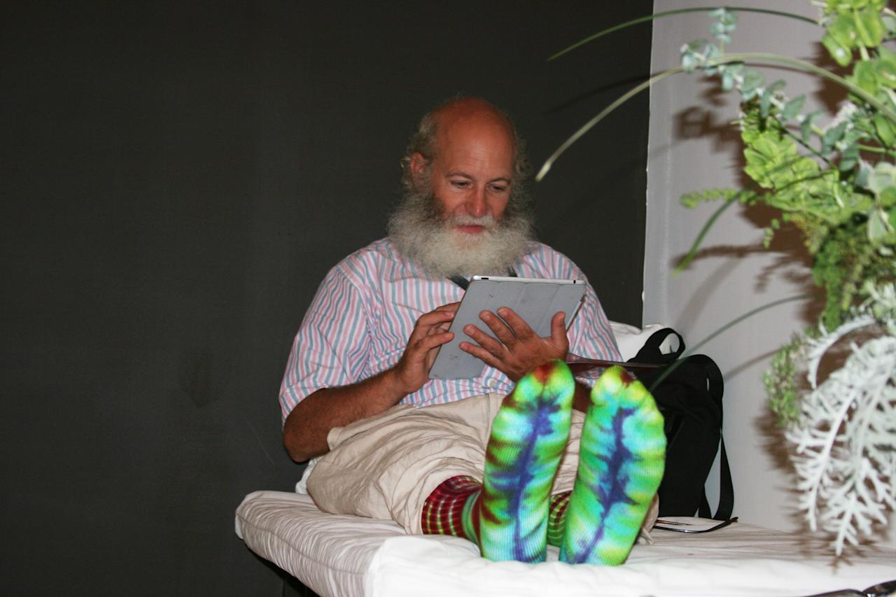 A man with tie-dyed socks made of bamboo relaxes at the Huffington Post Oasis on Wednesday Sept. 5, 2012. (Torrey AndersonSchoepe/Yahoo! News)