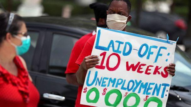 PHOTO: Joseph Louis joins others in a protest asking the state of Florida to fix its unemployment system on May 22, 2020 in Miami Beach, Fla. (Joe Raedle/Getty Images)