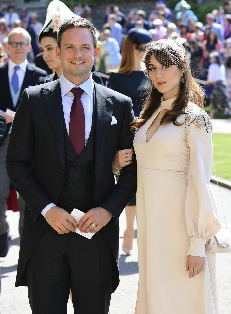 Patrick J. Adams and wife Troian Bellisario arrive a for the wedding ceremony of Prince Harry.