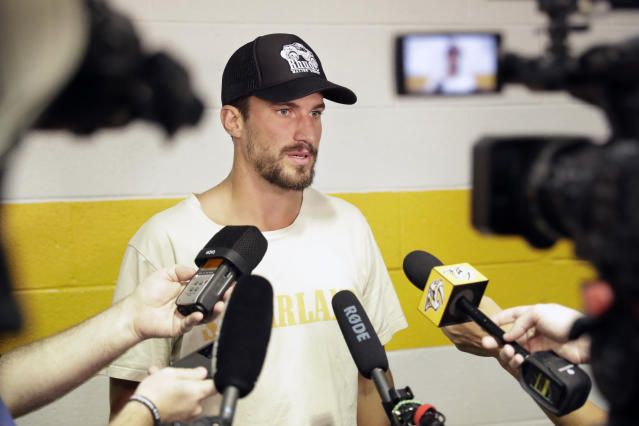 Nashville Predators defenseman Roman Josi, of Switzerland, answers questions as players report to NHL hockey training camp Thursday, Sept. 12, 2019, in Nashville, Tenn. (AP Photo/Mark Humphrey)