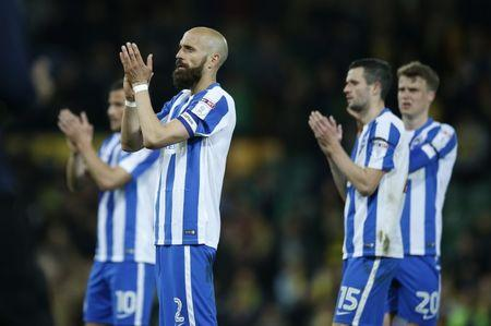 Brighton and Hove Albion's Bruno Saltor applauds fans after the match