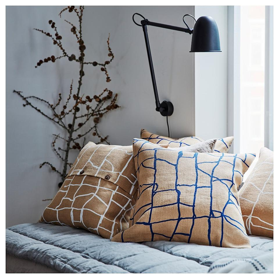 "<p>The natural colors on the <a href=""https://www.popsugar.com/buy/V%C3%A4rmer-Cushion-Cover-497183?p_name=V%C3%A4rmer%20Cushion%20Cover&retailer=ikea.com&pid=497183&price=8&evar1=casa%3Aus&evar9=46708916&evar98=https%3A%2F%2Fwww.popsugar.com%2Fhome%2Fphoto-gallery%2F46708916%2Fimage%2F46708922%2FV%C3%A4rmer-Cushion-Cover&list1=shopping%2Choliday%2Cikea%2Choliday%20decor&prop13=api&pdata=1"" rel=""nofollow"" data-shoppable-link=""1"" target=""_blank"" class=""ga-track"" data-ga-category=""Related"" data-ga-label=""https://www.ikea.com/us/en/p/vaermer-cushion-cover-jute-blue-80440986/"" data-ga-action=""In-Line Links"">Värmer Cushion Cover </a> ($8) blend with any furniture piece for a Winter feel. </p>"