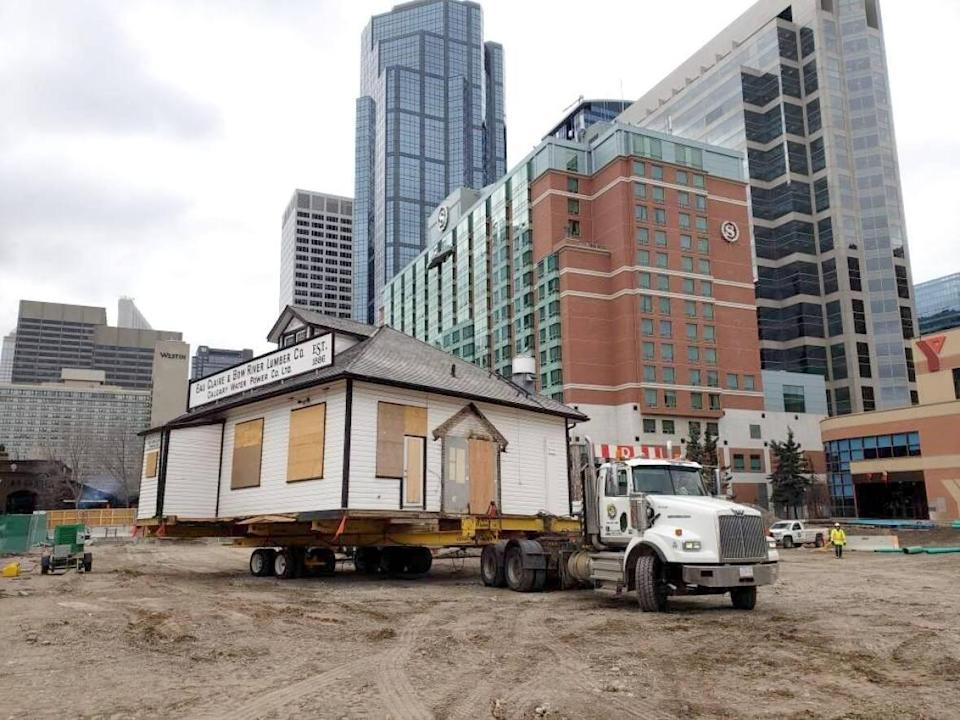 The building was moved early Thursday morning from the Eau Claire Plaza over to 381 Second Ave. S.W.    (Wade's House Moving and Heavy Hauling Ltd. - image credit)