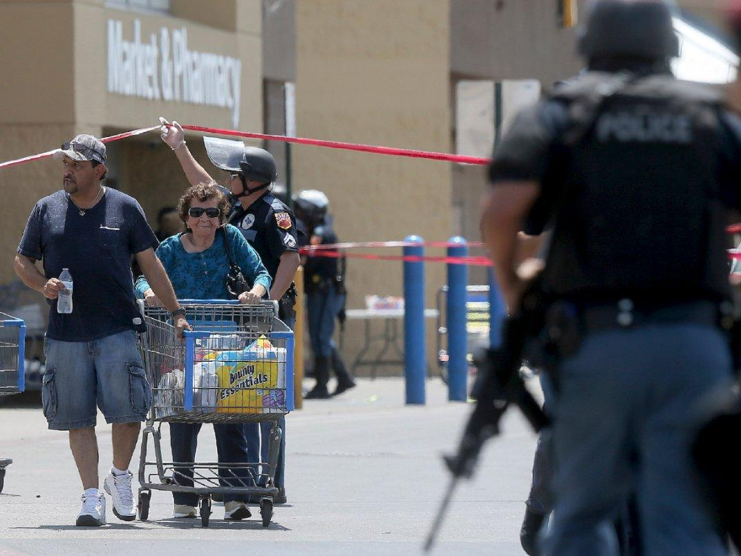 """""""U.S. President Donald Trump speaks at a campaign rally in Cincinnati"""" Reuters, Mark Lambie/The El Paso Times via Associated Press """"Walmart customers are escorted from the store after a gunman opened fire on shoppers near the Cielo Vista Mall, Saturday, Aug. 3, 2019, in El Paso, Texas."""""""