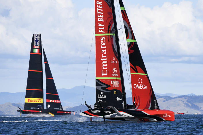 Italy's Luna Rossa, left, sails against Team New Zealand in race 4 of the America's Cup on Auckland's Waitemata Harbour, Friday, March 12, 2021. (Chris Cameron/Photosport via AP)