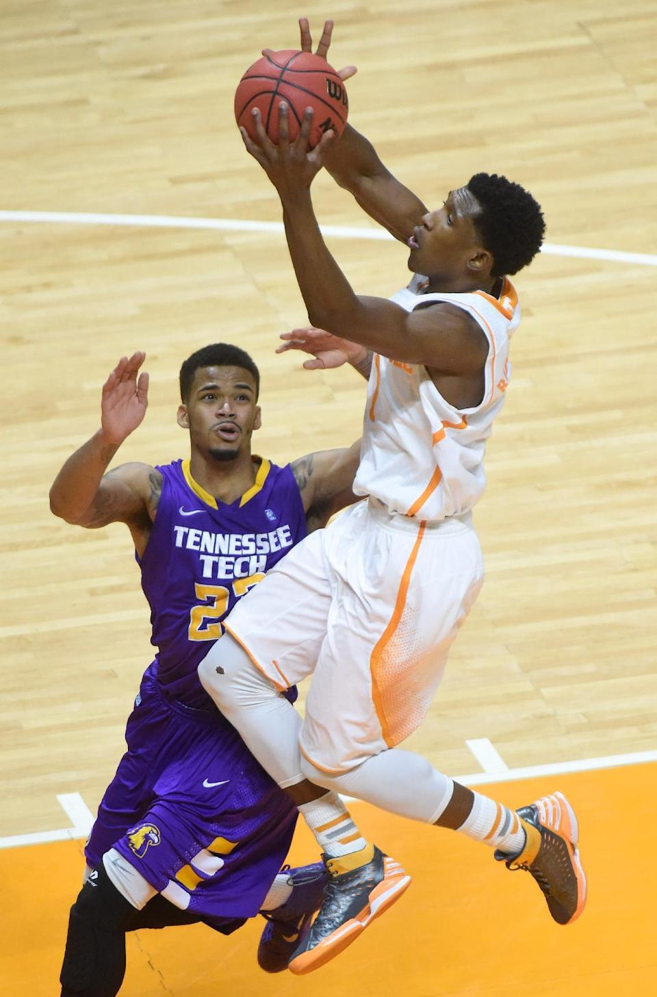 Tennessee guard Josh Richardson soars for a layup against Tennessee Tech guard Ty Allen during the second half of an NCAA college basketball game in Knoxville, Tenn. on Friday, Dec. 19, 2014. (AP Photo/Knoxville News Sentinel, Adam Lau)