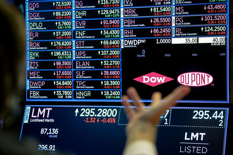 A screen displays the trading information for chemical producer DowDuPont Inc. on the floor at the NYSE in New York