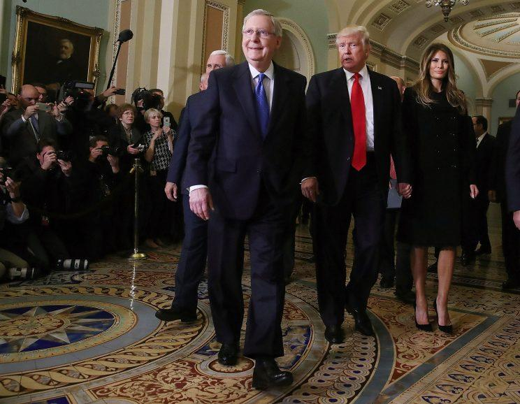 Senate Majority Leader Mitch McConnell (2L), walks with President-elect Donald Trump, his wife Melania Trump, and Vice President-elect Mike Pence (L), at the U.S. Capitol for a meeting November 10, 2016 in Washington, DC. Earlier in the day president-elect Trump met with U.S. President Barack Obama at the White House. (Mark Wilson/Getty Images)