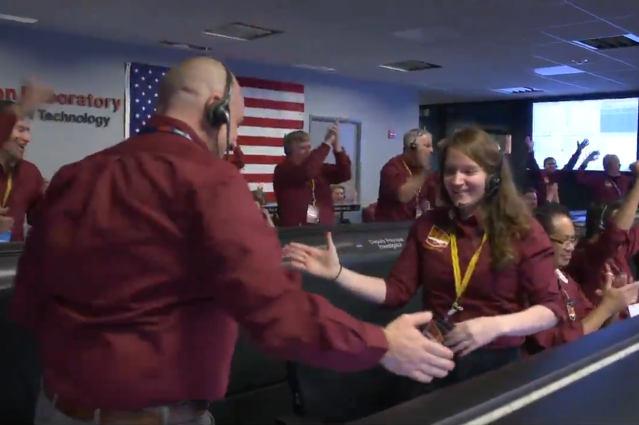 NASA engineers Gene and Brooke celebrated the InSight lander touching down on Mars with an elaborate NFL-inspired handshake. (Twitter/@NASAJPL)