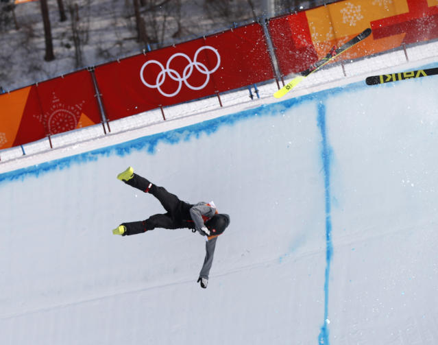 Joel Gisler falls after crashing during the halfpipe event. (Issei Kato / Reuters)