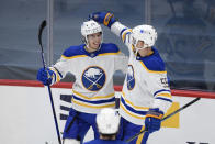 Buffalo Sabres center Dylan Cozens, left, celebrates his goal with defenseman Rasmus Ristolainen (55) during the second period of an NHL hockey game against the Washington Capitals, Friday, Jan. 22, 2021, in Washington. (AP Photo/Nick Wass)
