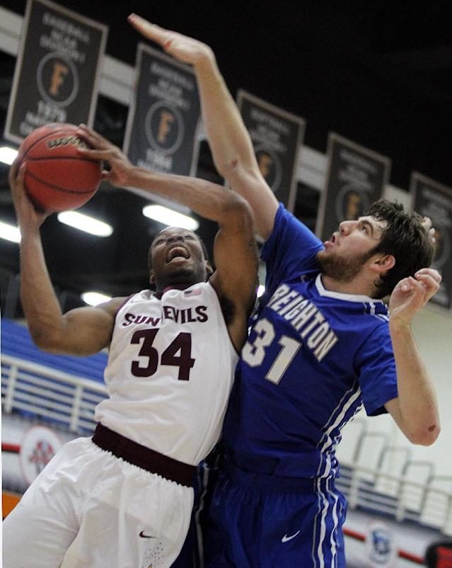 Arizona State guard Jermaine Marshall (34) goes up for a shot with Creighton center Will Artino (31) defending in the first half of an NCAA college basketball game at the Wooden Legacy tournament Thursday, Nov. 28, 2013, in Fullerton, Calif. (AP Photo/Alex Gallardo)