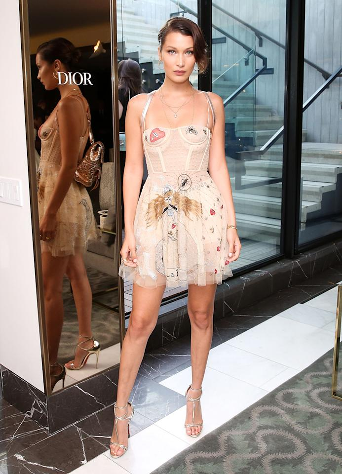 <p>Model Bella Hadid has experimented with many versions of the Dior dress. For a makeup launch event on Thursday, June 1, 2017, for the fashion house, she wore a shorter, see-through style. (Photo: Marc Patrick/BFA/REX/Shutterstock) </p>