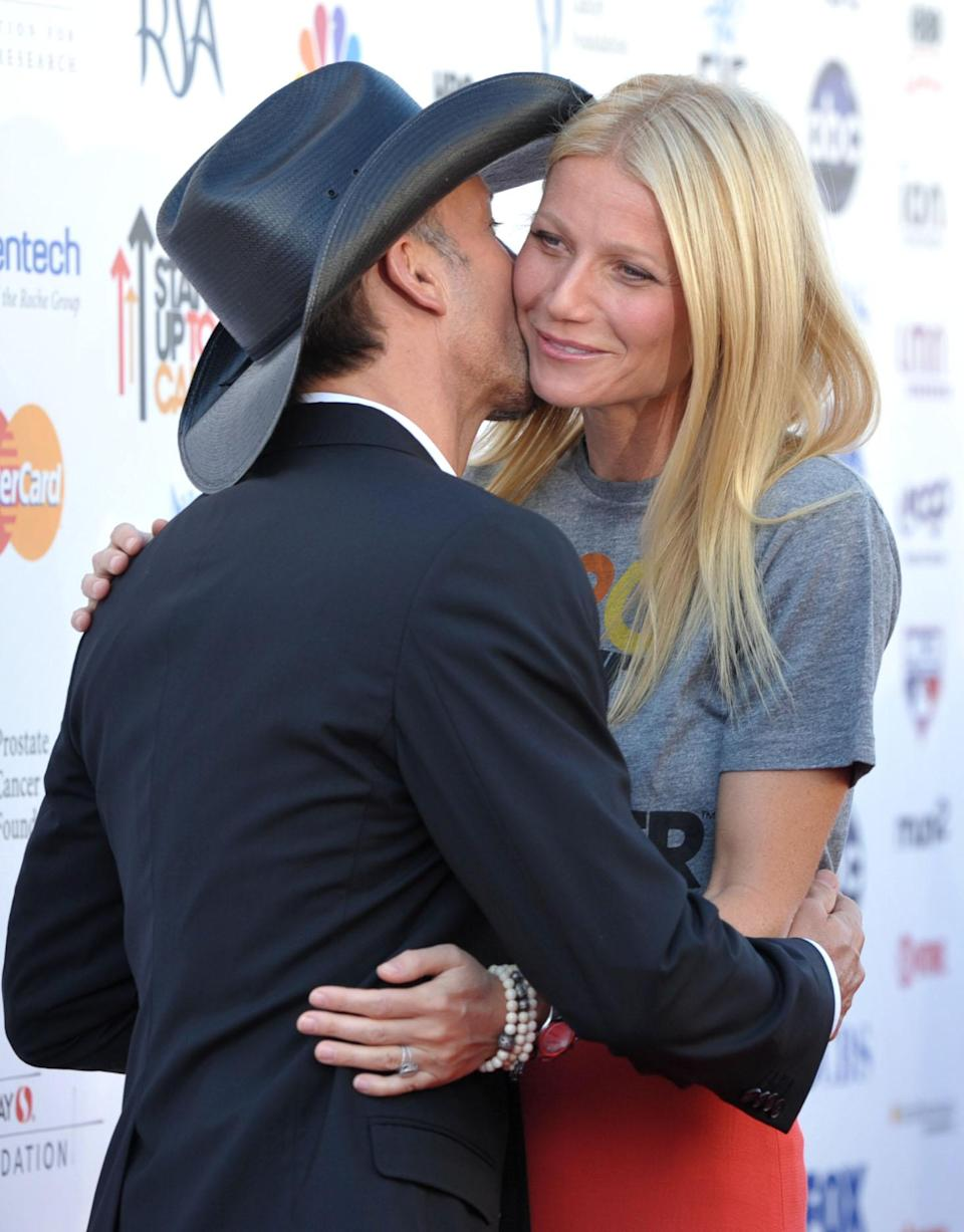 "Musician Tim McGraw, left, and actress Gwyneth Paltrow attend ""Stand Up to Cancer"" at the Shrine Auditorium on Friday, Sept. 7, 2012 in Los Angeles. The initiative aimed to raise funds to accelerate innovative cancer research by bringing new therapies to patients quickly. McGraw and Paltrow starred as a married couple in the film ""Country Strong."" Paltrow's father Bruce died from cancer in 2002. (Photo by John Shearer/Invision/AP)"