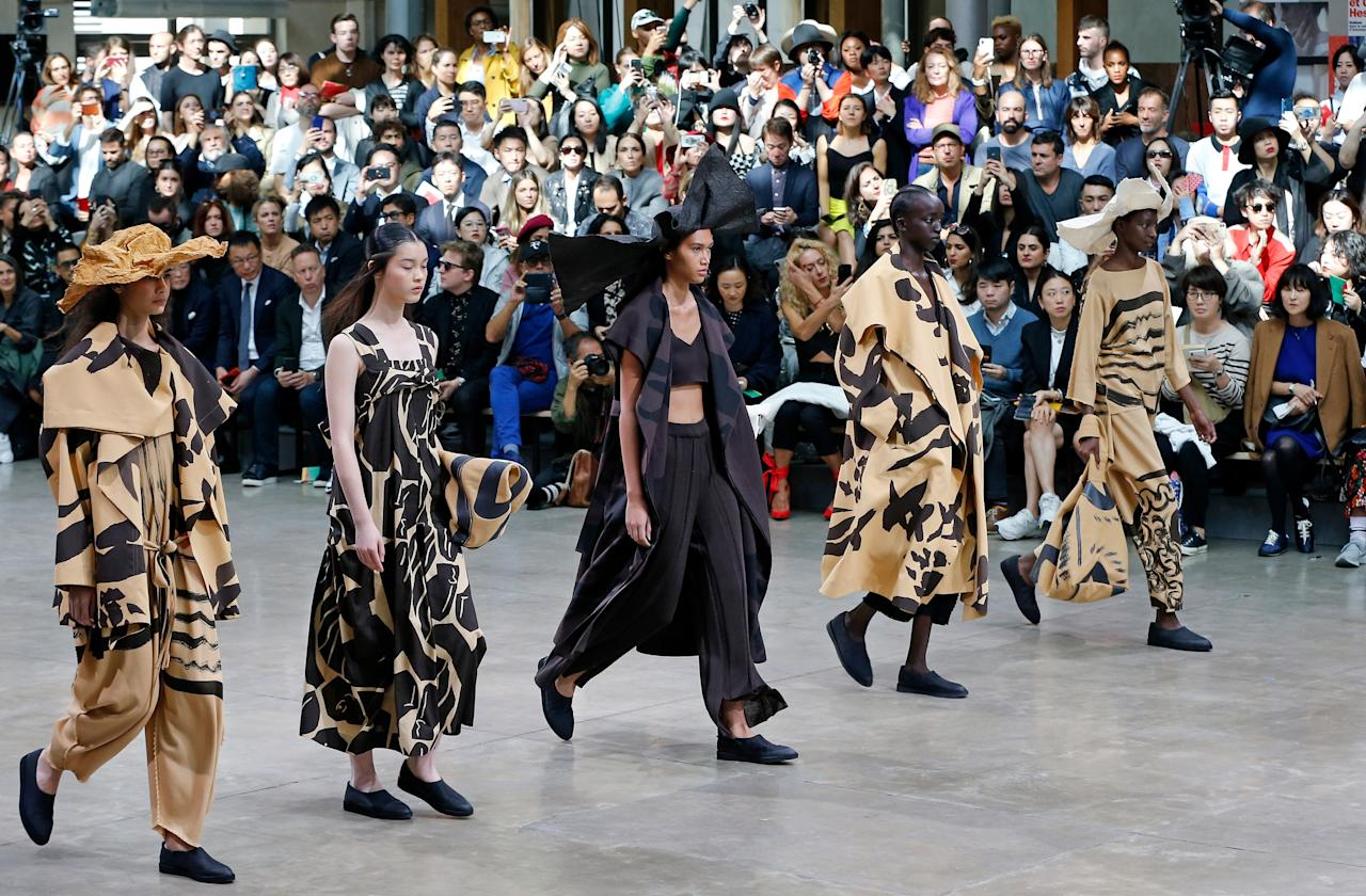 A lot was happening at the Issey Miyake show: girls opted for skateboards instead of heels and there was twirling, dancing, and bouncing around to demonstrate the movement of the pieces. The squad goals run deep here with head-to-toe brushstroke khaki pieces and a minimal all-black set.