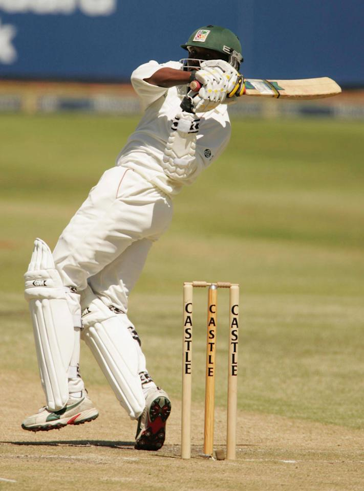 NEWLANDS, SOUTH AFRICA - MARCH 5:  (TOUCHLINE PHOTO IMAGES ARE AVAILABLE TO CLIENTS IN THE UK, USA AND AUSTRALIA ONLY) Hamilton Masakadza of Zimbabwe hits out during day two of the first test against Zimbabwe at Newlands March 5, 2005 in Cape Town, South Africa. (Photo by Touchline Photo/Getty Images)