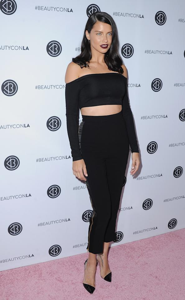 <p>The Victoria's Secret model looked like a gothic Barbie in an all-black look.<br /><i>[Photo: Getty]</i> </p>