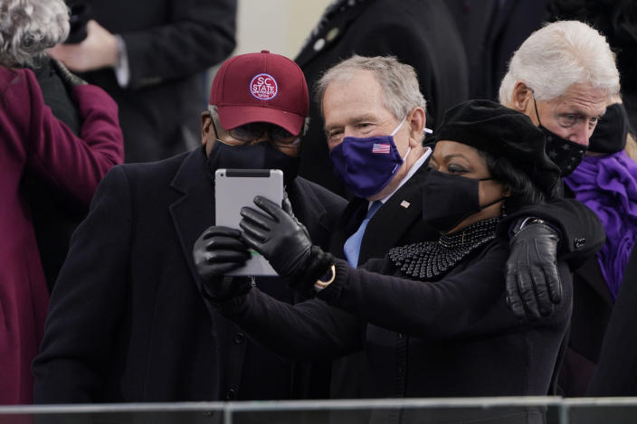 House Majority Whip James Clyburn of South Carolina, and former President George Bush, take a selfie before the 59th Presidential Inauguration at the U.S. Capitol in Washington, Wednesday, Jan. 20, 2021. (AP Photo/Patrick Semansky, Pool)