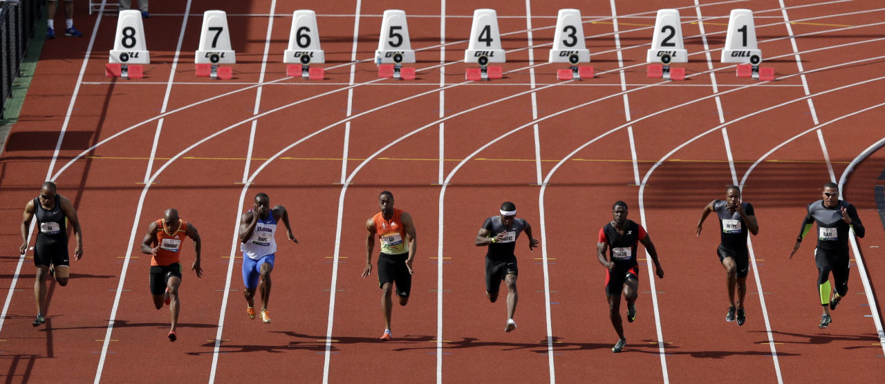 Runners participate in the men's 100m final at the U.S. Olympic Track and Field Trials Sunday, June 24, 2012, in Eugene, Ore. (AP Photo/Charlie Riedel)