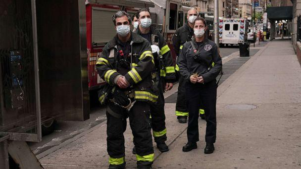 PHOTO: FDNY firefighters show gratitude to medical and frontline workers at Lenox Hill Hospital during the coronavirus pandemic, May 17, 2020, in New York City. (Cindy Ord/Getty Images)