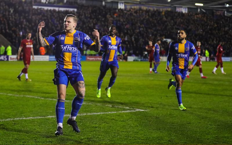 Jason Cummings of Shrewsbury Town celebrates after scoring a goal to make it 1-2 during the FA Cup Fourth Round match between Shrewsbury Town and Liverpool  - Getty Images Europe