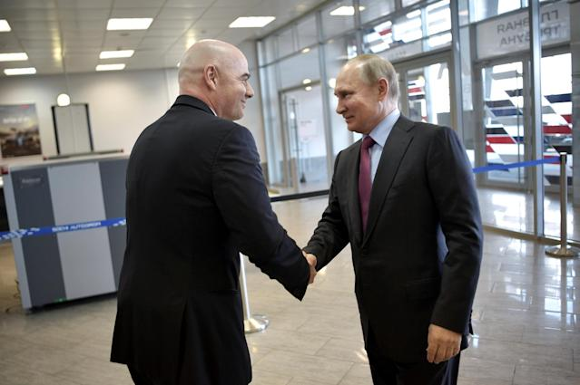 Russian President Vladimir Putin (R) shakes hands with FIFA President Gianni Infantino as they visit a 2018 FIFA World Cup FAN ID distribution centre in Sochi, Russia May 3, 2018. Sputnik/Aleksey Nikolskyi/Kremlin via REUTERS ATTENTION EDITORS - THIS IMAGE WAS PROVIDED BY A THIRD PARTY.